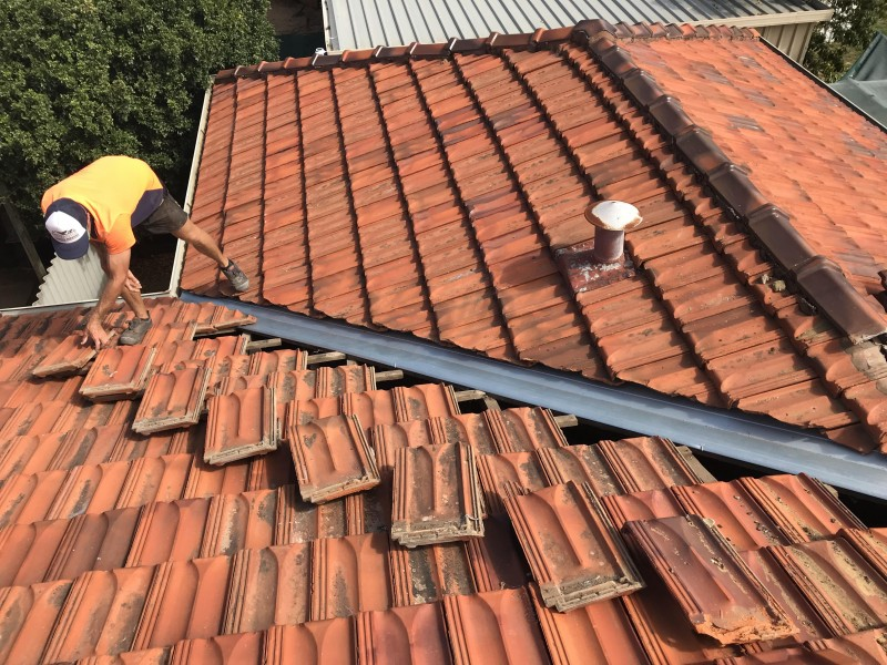 roofing contractor working on roof